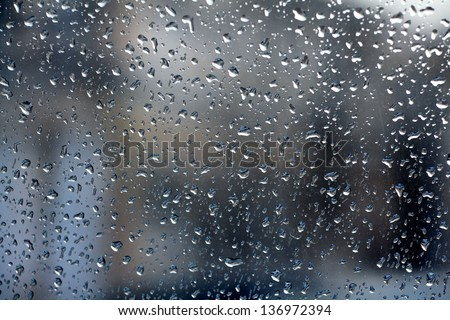 raindrops on glass blur - stock photo