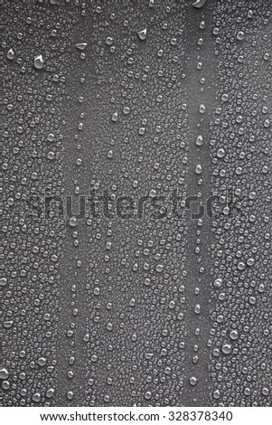 Raindrops on gray metal surface - stock photo