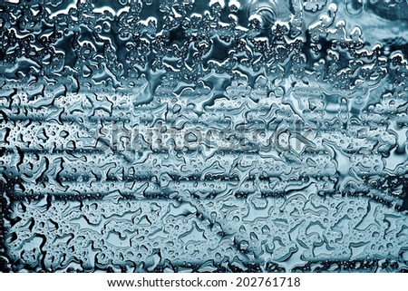Raindrops on mirror (ideal for unique abstract wallpapers). - stock photo