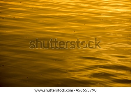 raindrops on the sea at sunset