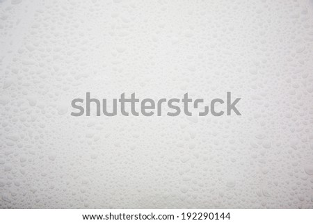 raindrops on white car - stock photo