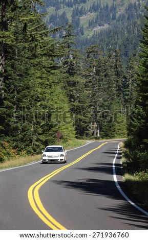 Rainier National Park, Washington, USA Aug. 26, 2014 A car driving on a paved road at high elevations in Rainier National Park.