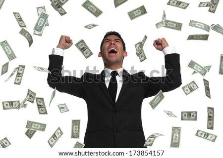 Raining money on a celebrating businessman