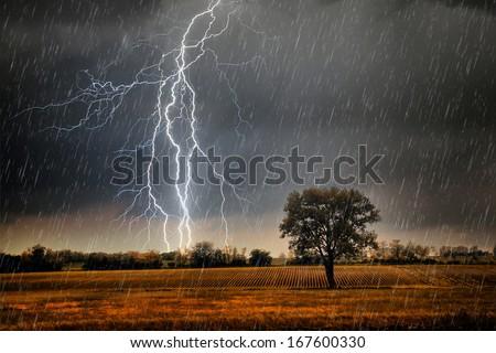 Rainstorm over beautiful landscape - stock photo