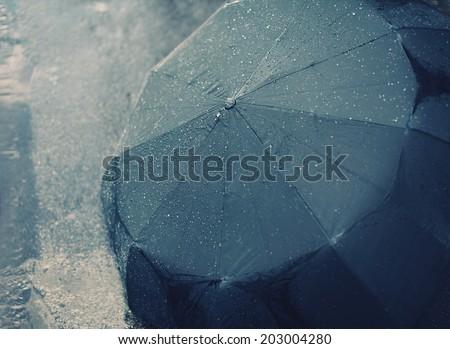 Rainy autumn day, wet umbrella - stock photo