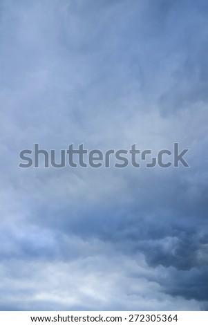 Rainy clouds over horizon. Storm sky background. - stock photo