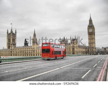 Rainy day at the Houses of Parliament with red bus, London, UK