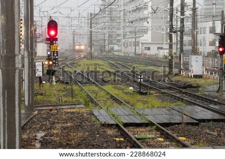 Rainy day at the  railway station, Japan - stock photo