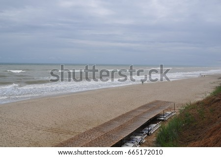 Rainy day in Black sea, access staircase to beach .Steps to seaside