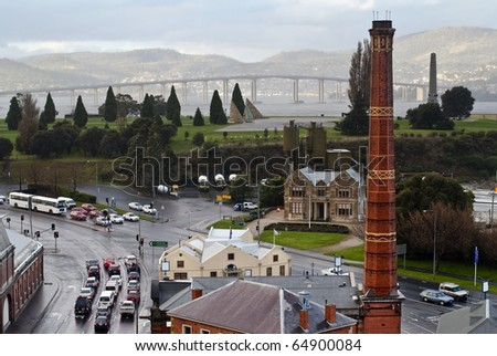 Rainy day in Hobart, Tasmania, Australia. Unique views of old gasworks tower, the Domain, Tasman Bridge and the eastern shore. - stock photo