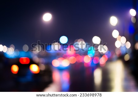 Rainy day in the city at night, a car rides through the night city - stock photo