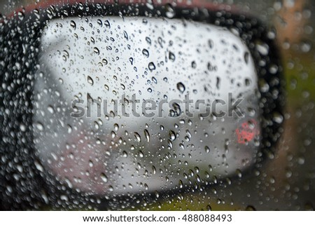 Rainy days, Rain drops on a car window, Rain drops, Street in the heavy rain, road view through car windshield with rain drops,  Driving in rain, blurred image of view through a car window in rainy