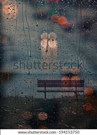 Rainy days,Rain drops on window,rainy weather,rain background,rain and bokeh - stock photo