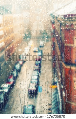 Rainy days,Rain drops on window with street view ,rainy weather,rain background - stock photo
