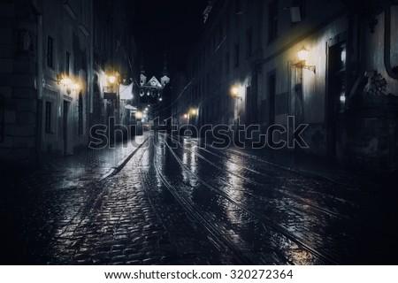 Rainy night in old European city - stock photo