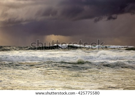 Rainy seascape with menacing clouds and beautiful light