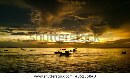 rainy season at sea have sunshine orangecolor and gold cloudy sky ,rainy season fishing boat on sea, This sea cloudy and crazyclouds - stock photo