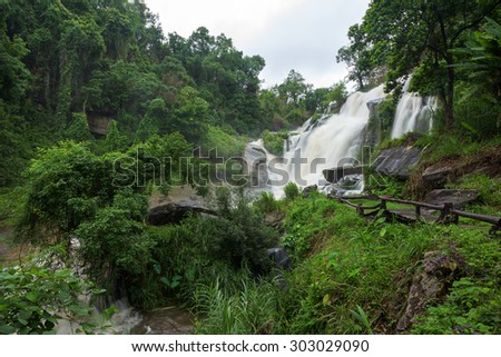 Rainy season, waterfall in forest at Chiang mai, Thailand. - stock photo