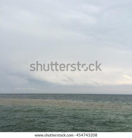 rainy sky and beautiful view on the sea - stock photo