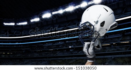 Raised Football Helmet at an American Football Stadium - stock photo