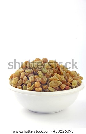 Raisin In White Bowl on White background