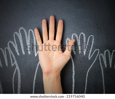 Raising hands against blackboard background. Hand doodle drawn on chalkboard background. - stock photo