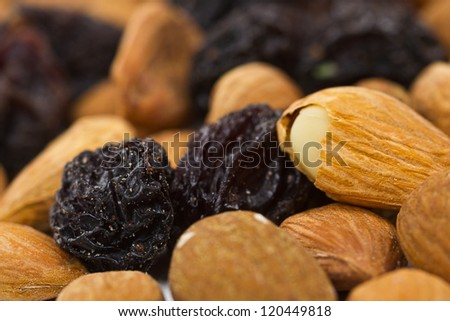 raisins and nuts close background - stock photo