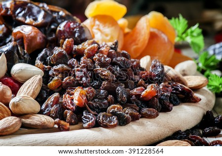 Raisins, dried grapes, dried fruit and nut mix, selective focus