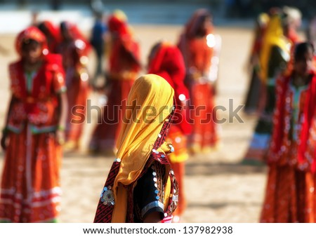 Rajasthan India  Dance performance of indian women dressed in traditional colorful clothes - stock photo