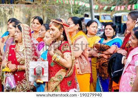RAJASTHAN, INDIA - FEB 8th: The Rajasthan bride and bride-mother are celebrating with the relatives and friends during the wedding ceremony on february  8th 2012 in Rajasthan, India  - stock photo