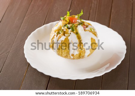 Rajasthani Shahi Raj Kachori, stuffed katchori with potato and sprout filling and served with curd, chutney and sev - stock photo