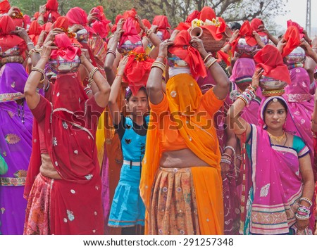 RAJSAMAND, INDIA - MARCH 7, 2015: Women in a procession during the Hindu festival of Gangaur which lasts for 16 days and is marked throughout Rajasthan to celebrate marriage and the onset of Spring - stock photo