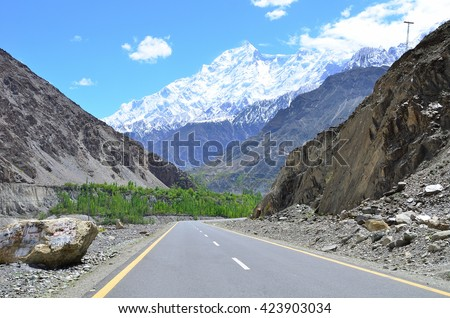 Rakaposhi peak is a mountain in the Karakoram range in Pakistan along the way to Hunza valley - stock photo