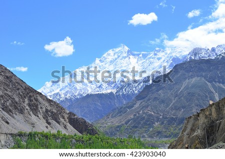 Rakaposhi peak is a mountain in the Karakorum highway in Northern of Pakistan along the way to Hunza valley - stock photo
