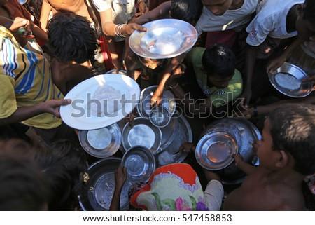 RAKHINE STATE, MYANMAR - NOVEMBER 05 : Rohingya people are receiving food from donations, on NOVEMBER, 2015 in Sittwe, Myanmar.