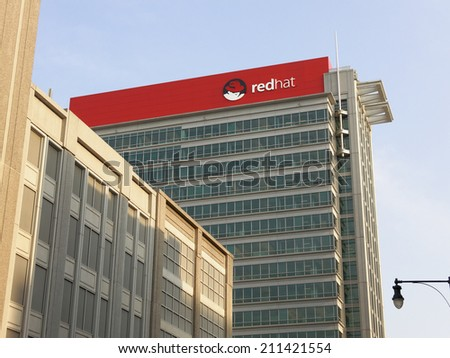 RALEIGH, NC  AUGUST 7: The Red Hat World Headquarters building located in downtown Raleigh, North Carolina on August 7, 2014. Red Hat, Inc. is in American multinational software company. - stock photo