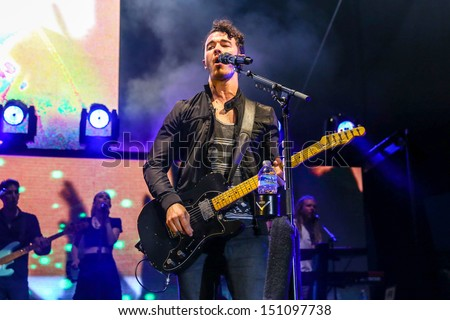Raleigh, NC - July 31:  Kevin Jonas of The Jonas Brothers perform a concert on their 2013 Jonas Brothers Live Tour on July 31, 2013 in Raleigh, NC. - stock photo