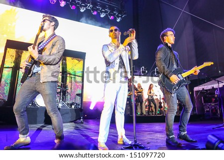 Raleigh, NC - July 31:  The Jonas Brothers perform a concert on their 2013 Jonas Brothers Live Tour on July 31, 2013 in Raleigh, NC. - stock photo