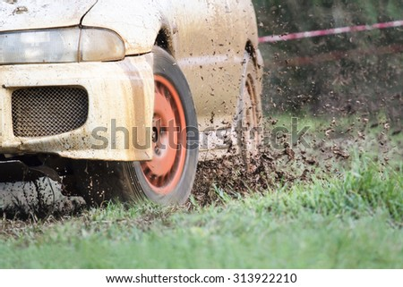 Rally car in muddy road - stock photo