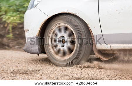 Rally Car speed in dirt track - stock photo