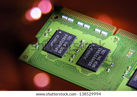 Ram card, Micro chip on a red lit background. - stock photo