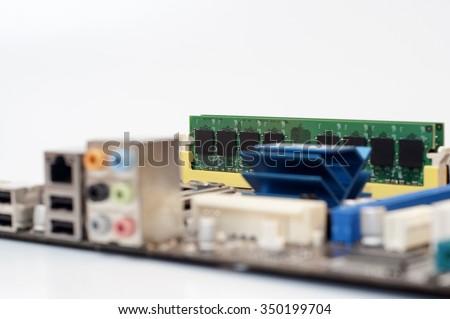 RAM Memory Module Installed On Computer Motherboard,(Soft focus, shallow DOF, slight motion blur) - stock photo