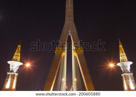 Rama VIII Bridge at night The brightness of the lamp across the bridge. - stock photo