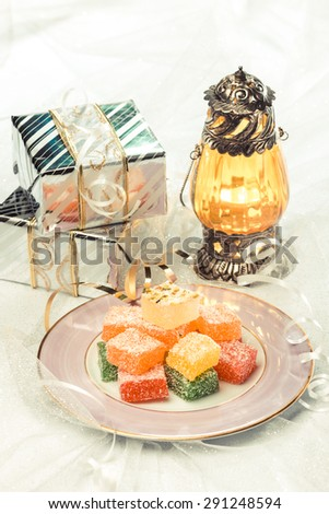 Ramadan and Eid festival background. Sweet, gifts and lantern. - stock photo