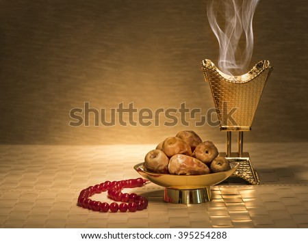 Ramadan dates with censer and rosary - stock photo