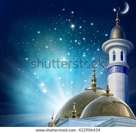 Ramadan Kareem background.Crescent moon at a top of a mosque - stock photo