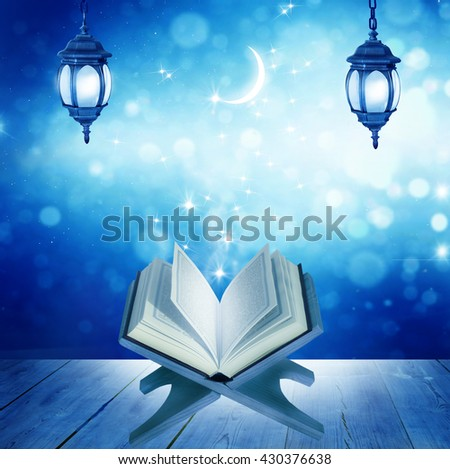 Ramadan Kareem background.Quran on a wooden book stand  - stock photo