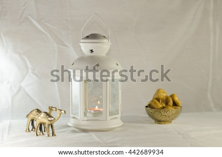 Ramadan Lightened Lantern with Dried figs and Copper camel - stock photo