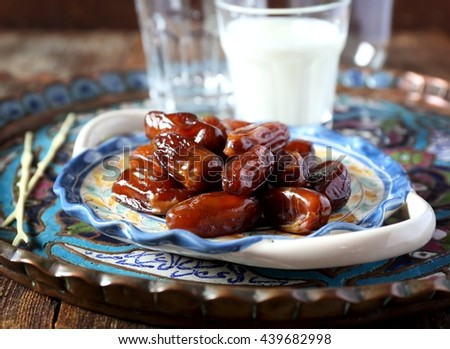 Ramadan: ripe dates and  fermented milk drink - stock photo