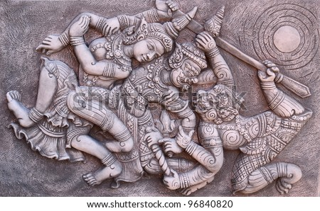 Ramayana bas-relief sculpture of Tosakan (ten face) giant , Thailand - stock photo